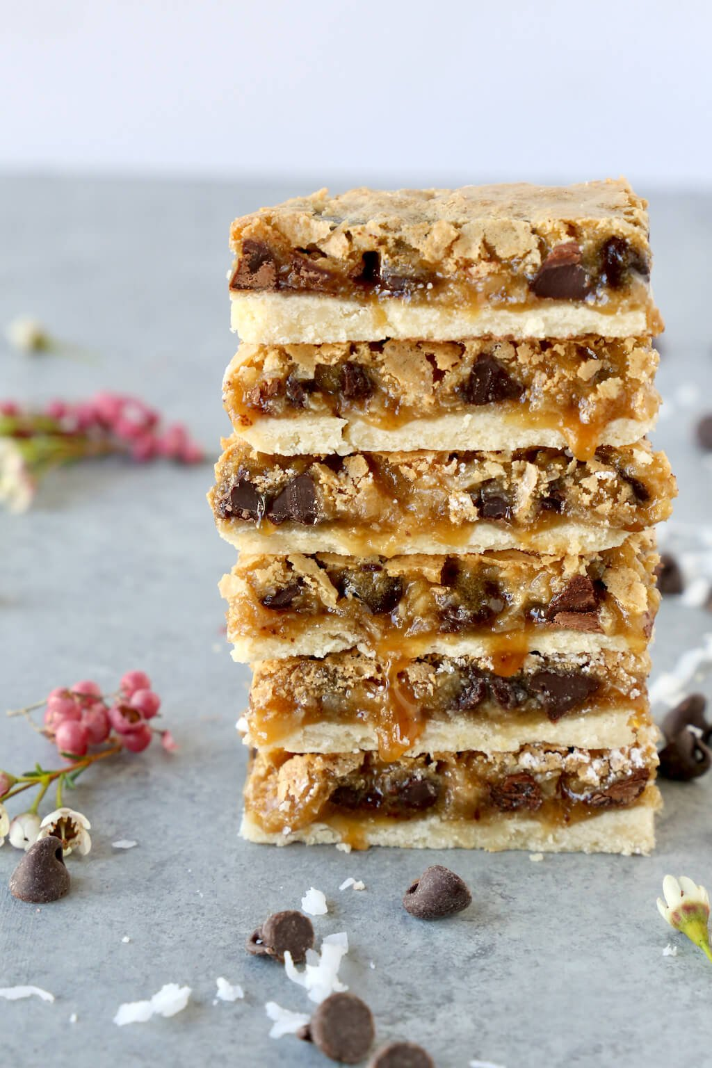 a stack of six yum yum bars with caramel drizzling down