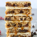 a stack of six bars with caramel drizzling down