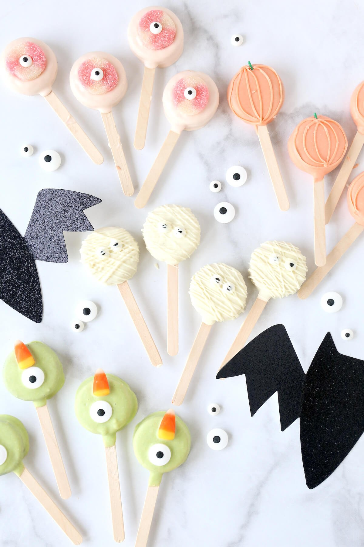Oreos on popsicle sticks, dipped in chocolate with candy eyes.