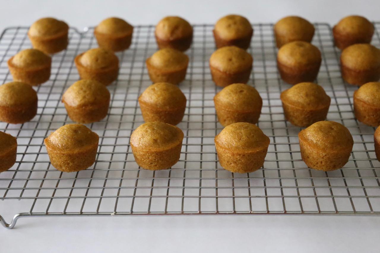 Plain mini pumpkin spice muffins on a cooling rack