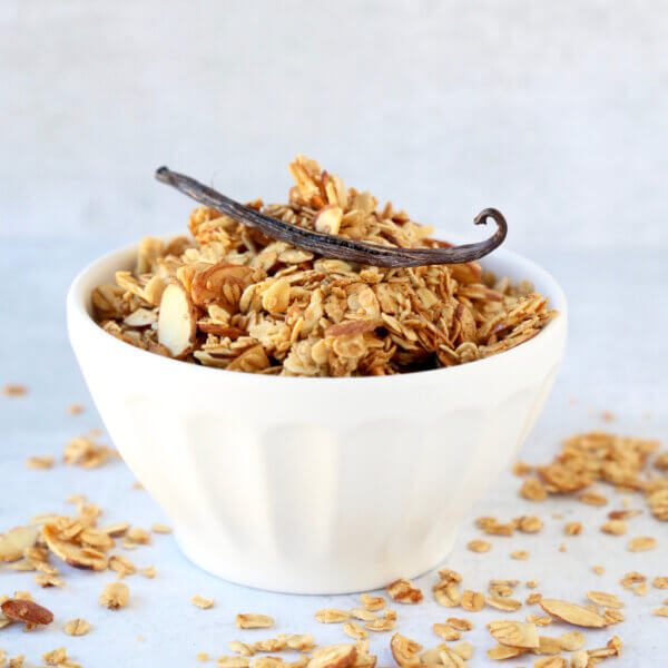 a white bowl filled with granola