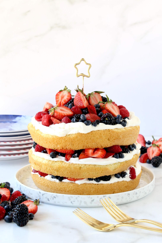 Three layers of sponge cake layered with fresh berries and whipped cream