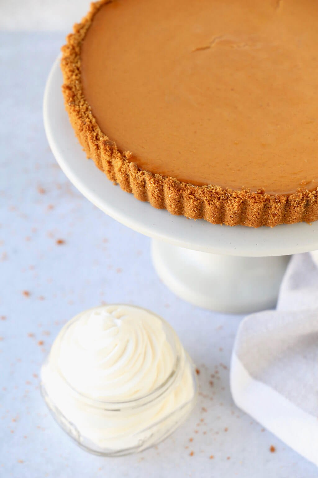 a close up of the pumpkin gingerbread tart and fresh whipped cream