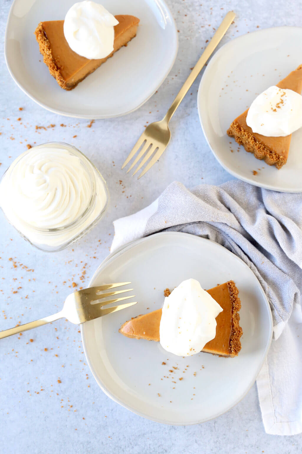 three slices of pumpkin gingerbread tart with fresh whipped cream
