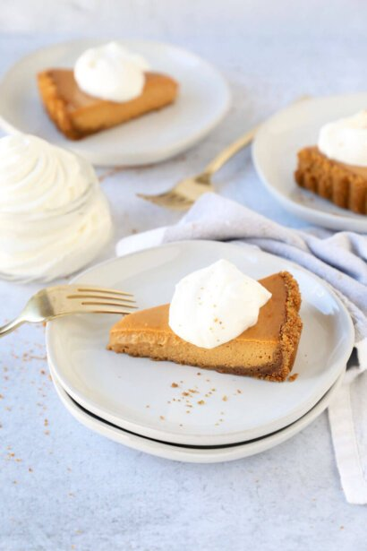 a slice of pumpkin gingerbread tart on a stack of plates