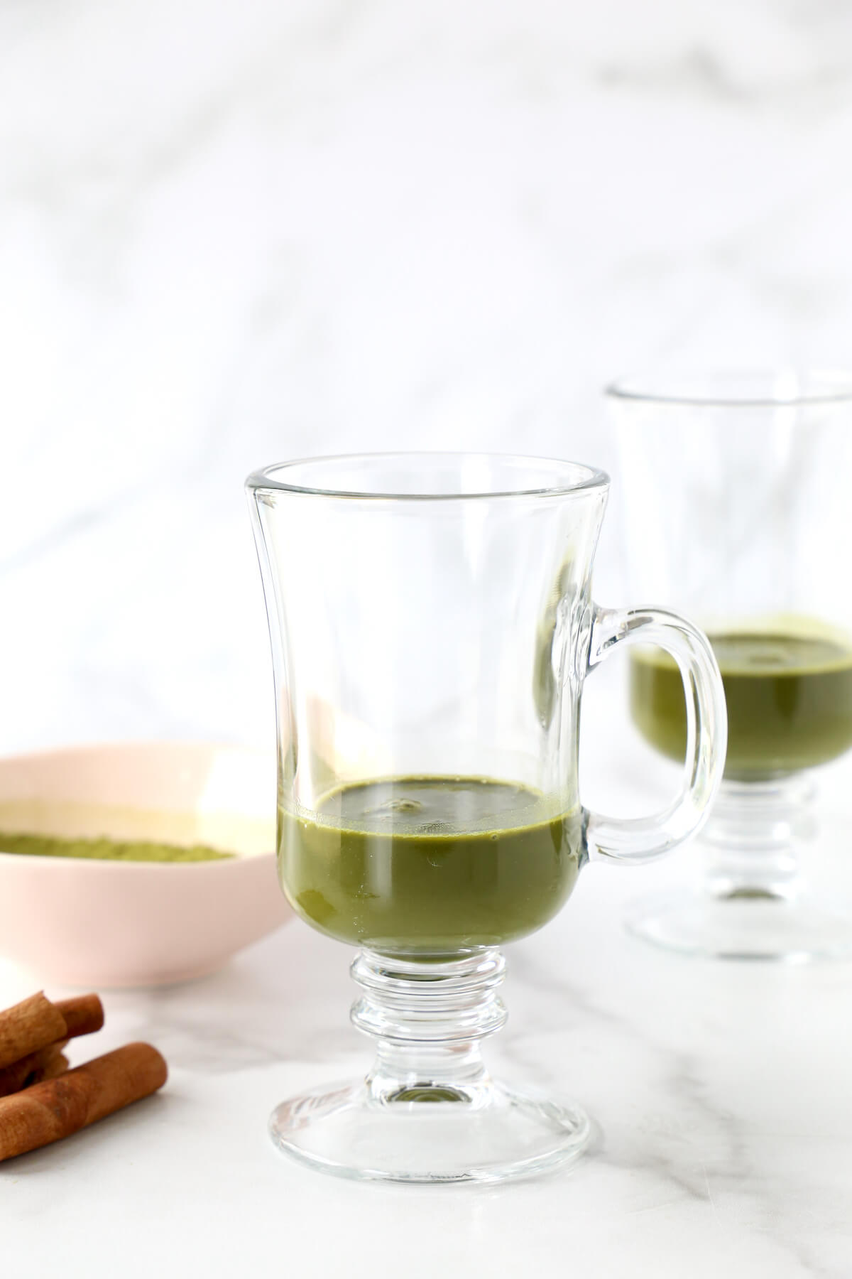 a glass of matcha tea