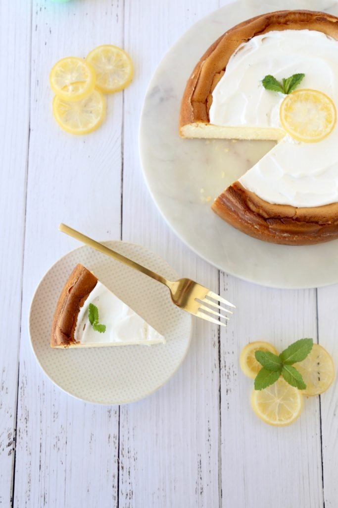 an overhead of a slice of cheesecake on a plate with a fork