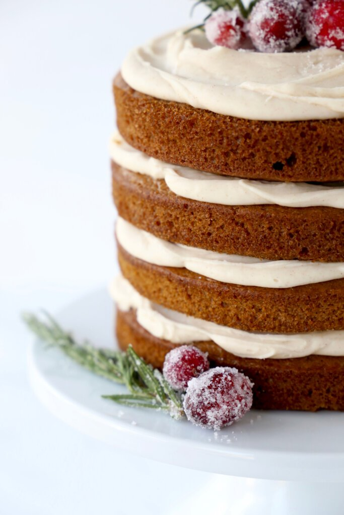 a close up of the layers of gingerbread cake and spiced icing