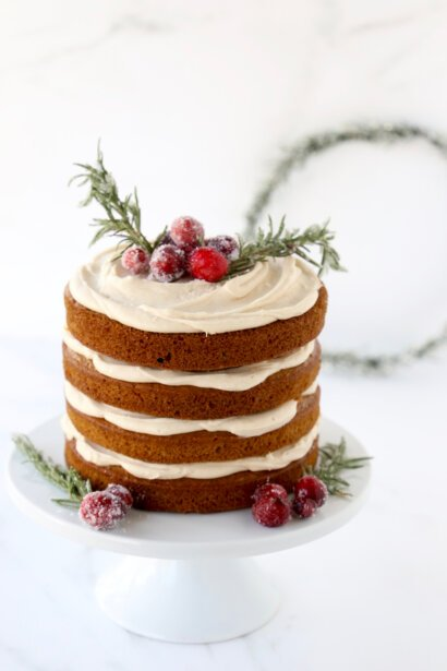 Layers of gingerbread cake and spiced cream cheese icing