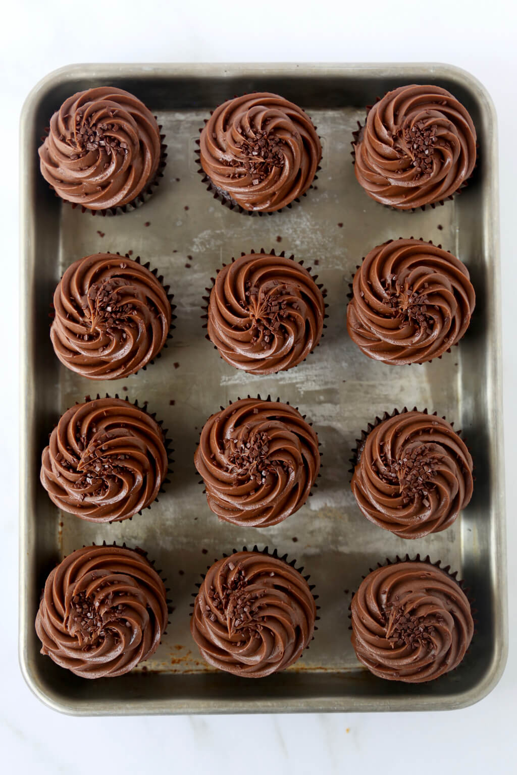 chocolate fudge cupcakes on a sheet pan