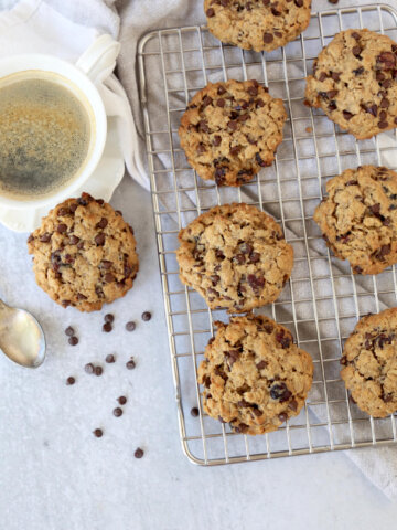 overhead view of breakfast cookies on a cooling rack and a cup of coffee