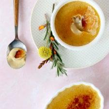 A ramekin with a spoonful of creme brûlée taken out