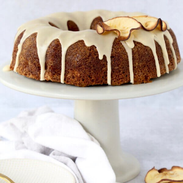 Apple Spice Bundt Cake on top of a cake stand