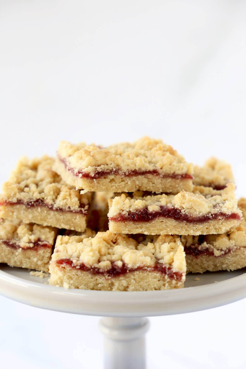 a close up of a pile of jam shortbread bars