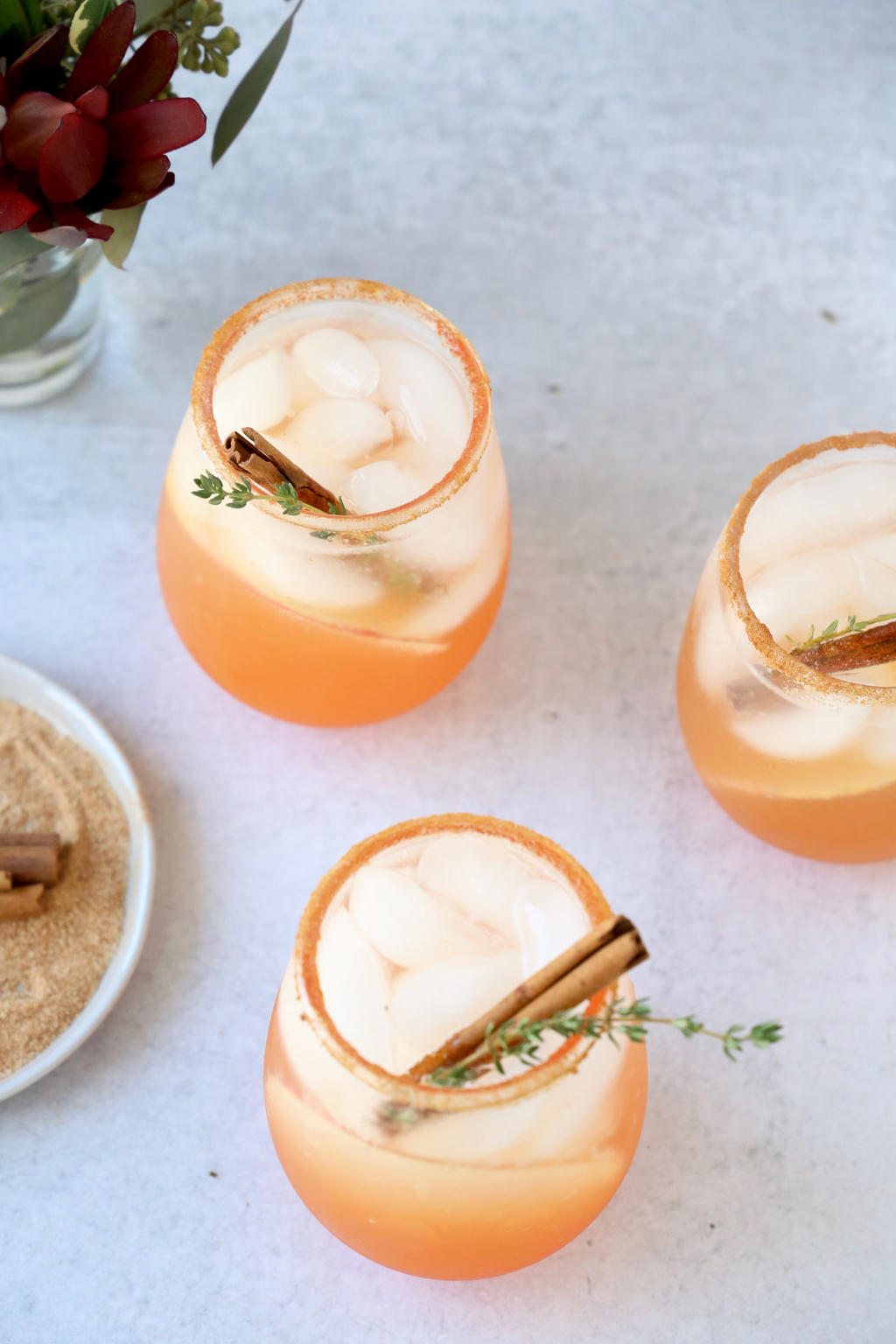 an overhead view of three apple cider aperol spritz cocktails