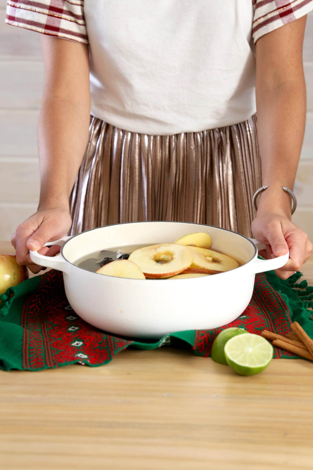 a girl holding the pot handles filled with christmas punch