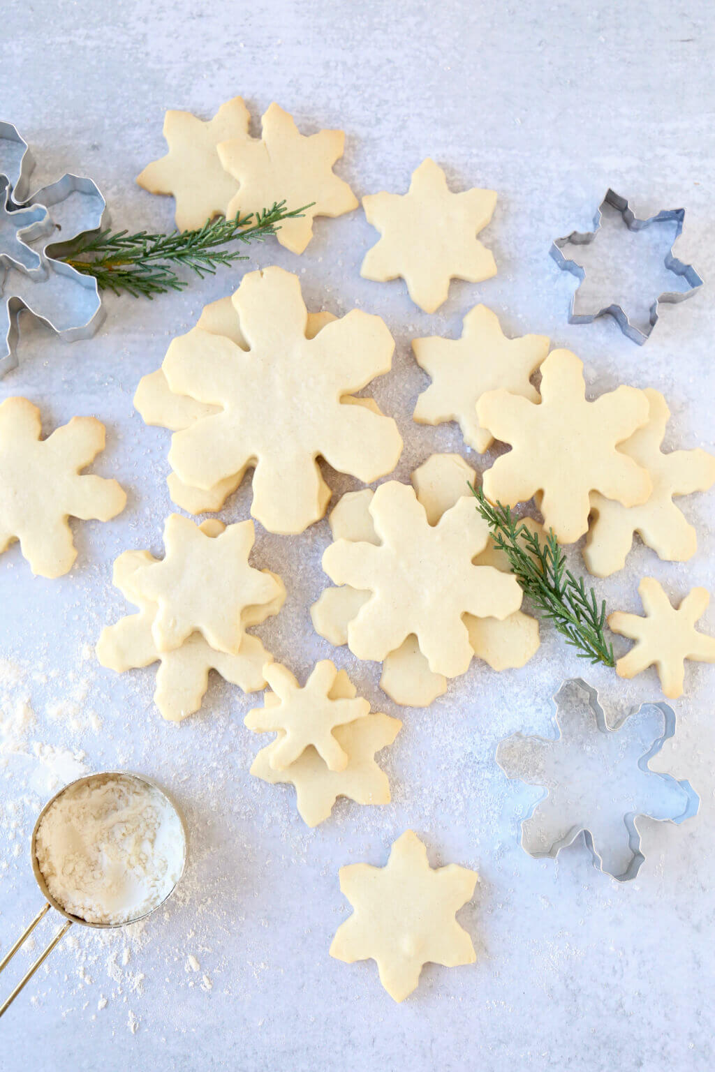 Snowflake cut out cookies stacked with greenery for decoration
