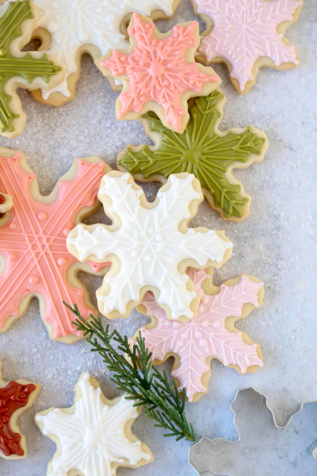 a stack of iced snowflake cookies