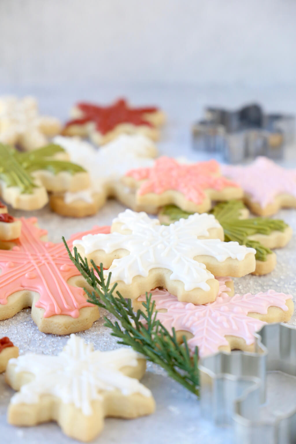 a stack of snowflake sugar cookies