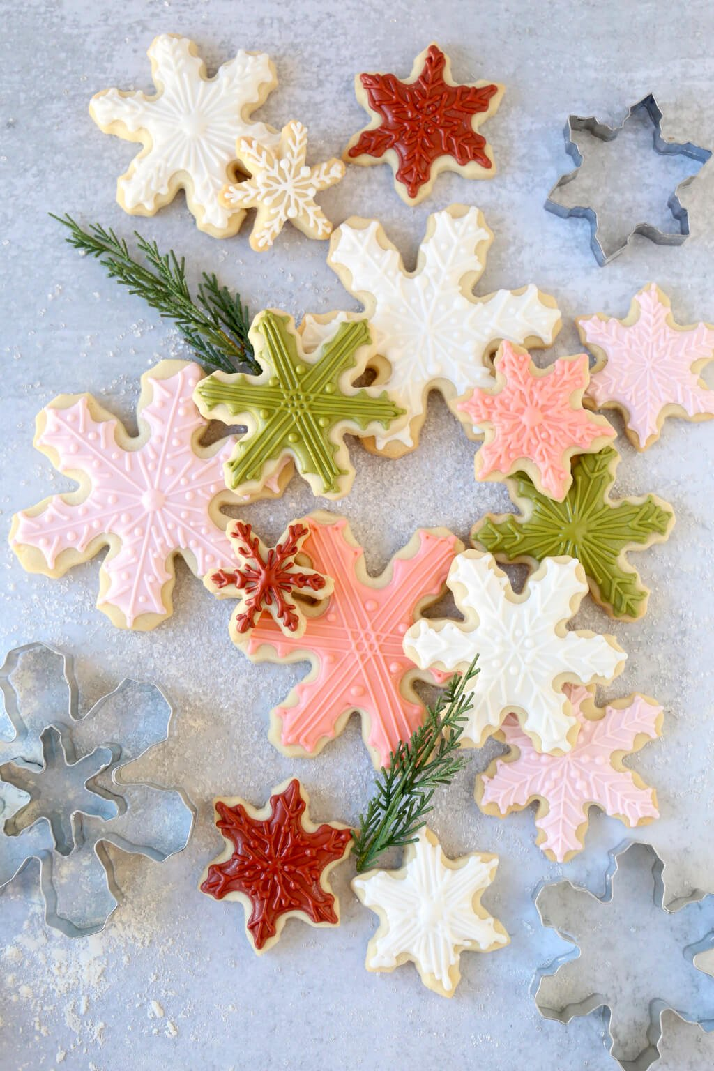 a stack of decorated snowflake sugar cookies