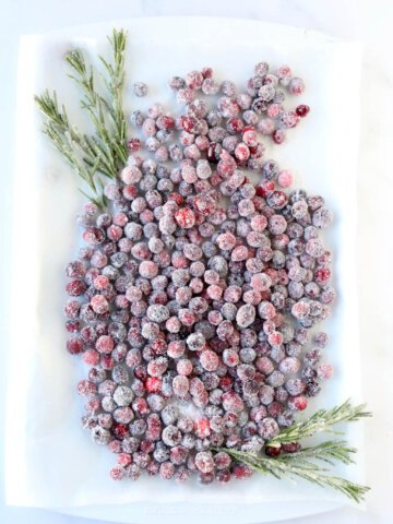 a tray full of sugared cranberries that are drying