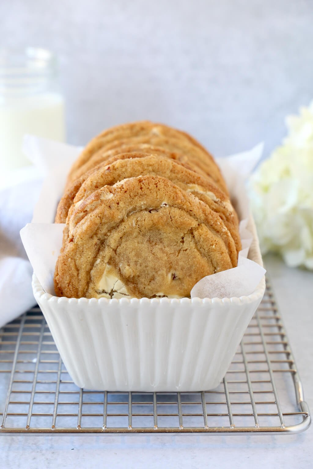cookies stacked in a white dish