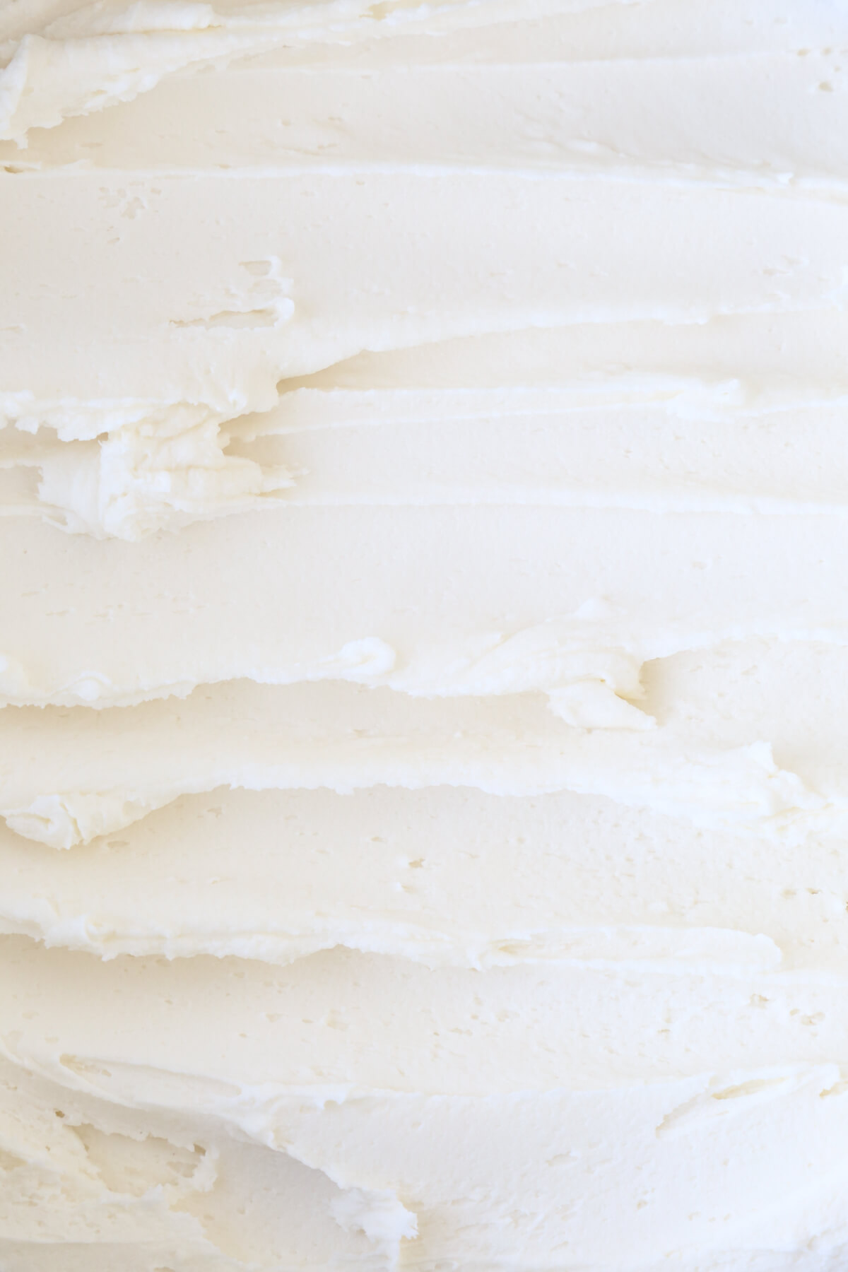 A close up of white frosting.