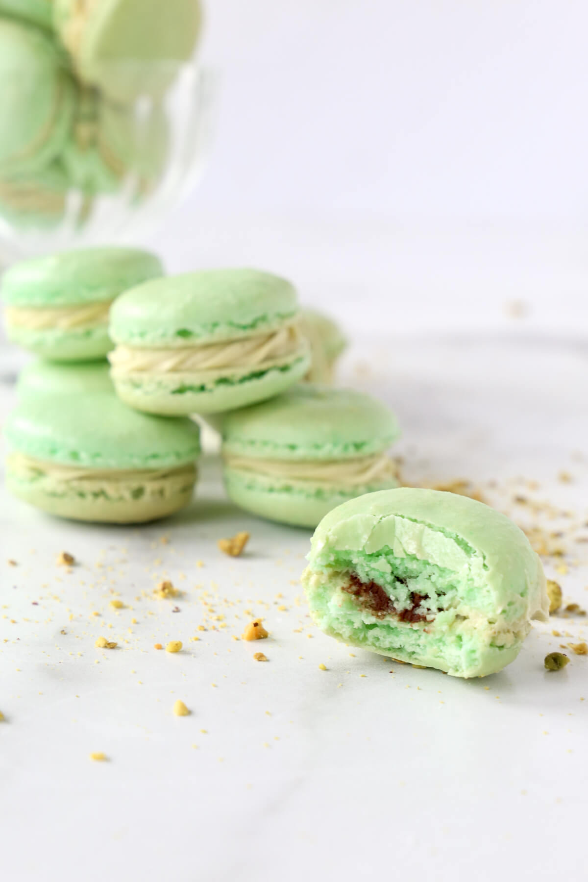 green cookies sandwiched together and one with a bite out of it.