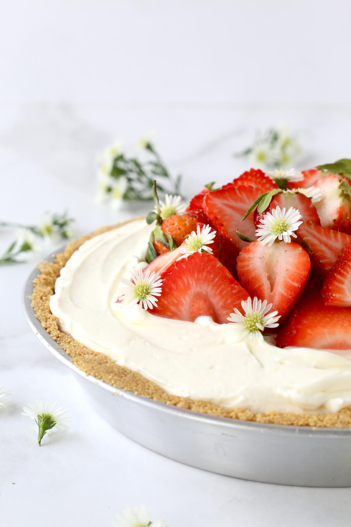 Graham cracker crust, whipped cheesecake filling, topped with fresh strawberries.