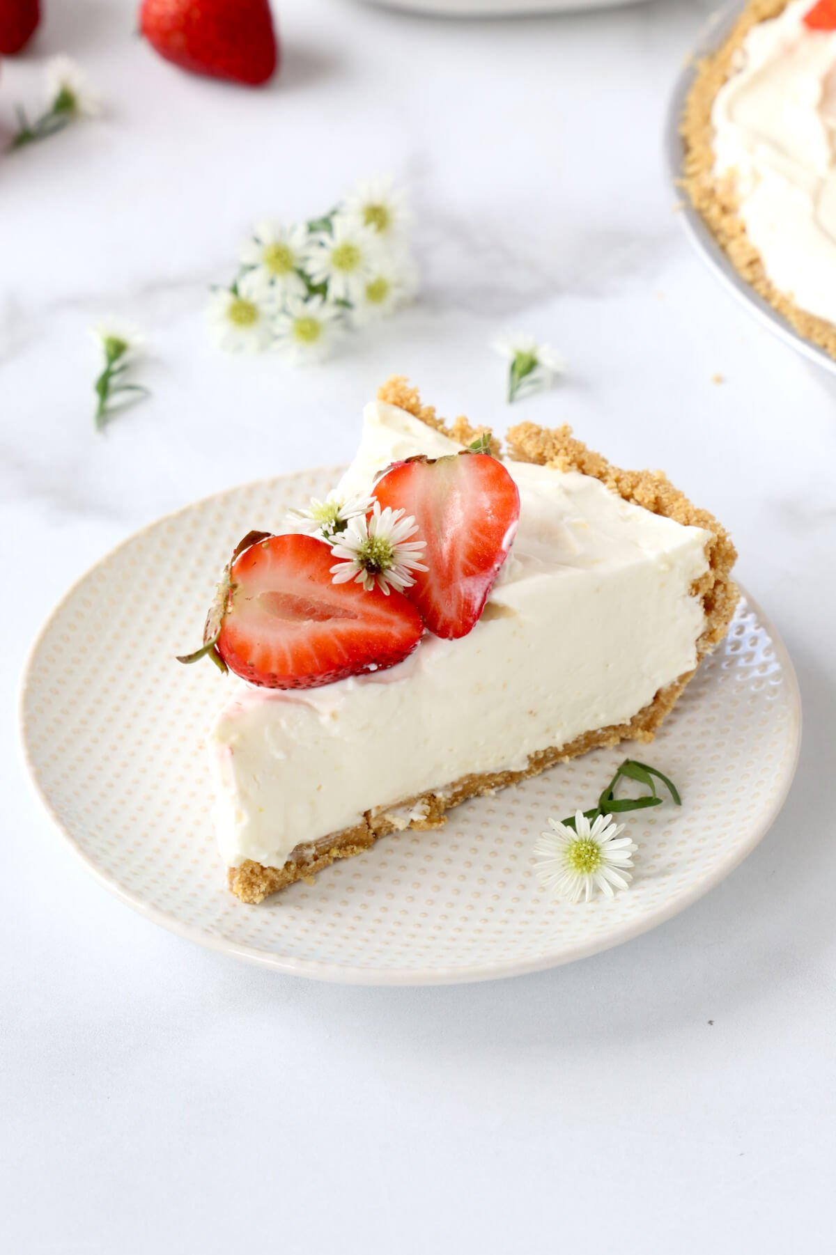 a slice of pie with fresh flowers