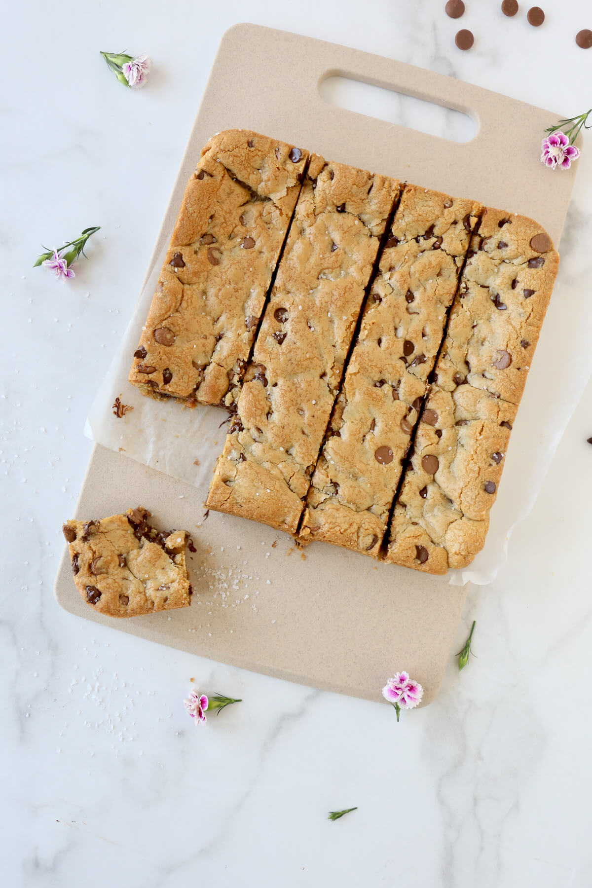 A square pan of blondies cut into smaller squares.